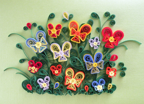 Paper filigree paper quilling can be used to do a great variety of designs such as flowers and animals that are used to ornate scrapbooks greeting cards and pictures mightylinksfo
